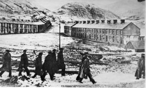 Miners passing Bush Houses
